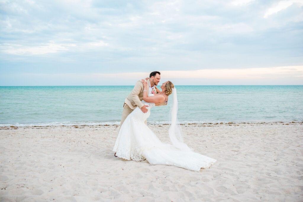 swept off her feet, beach wedding